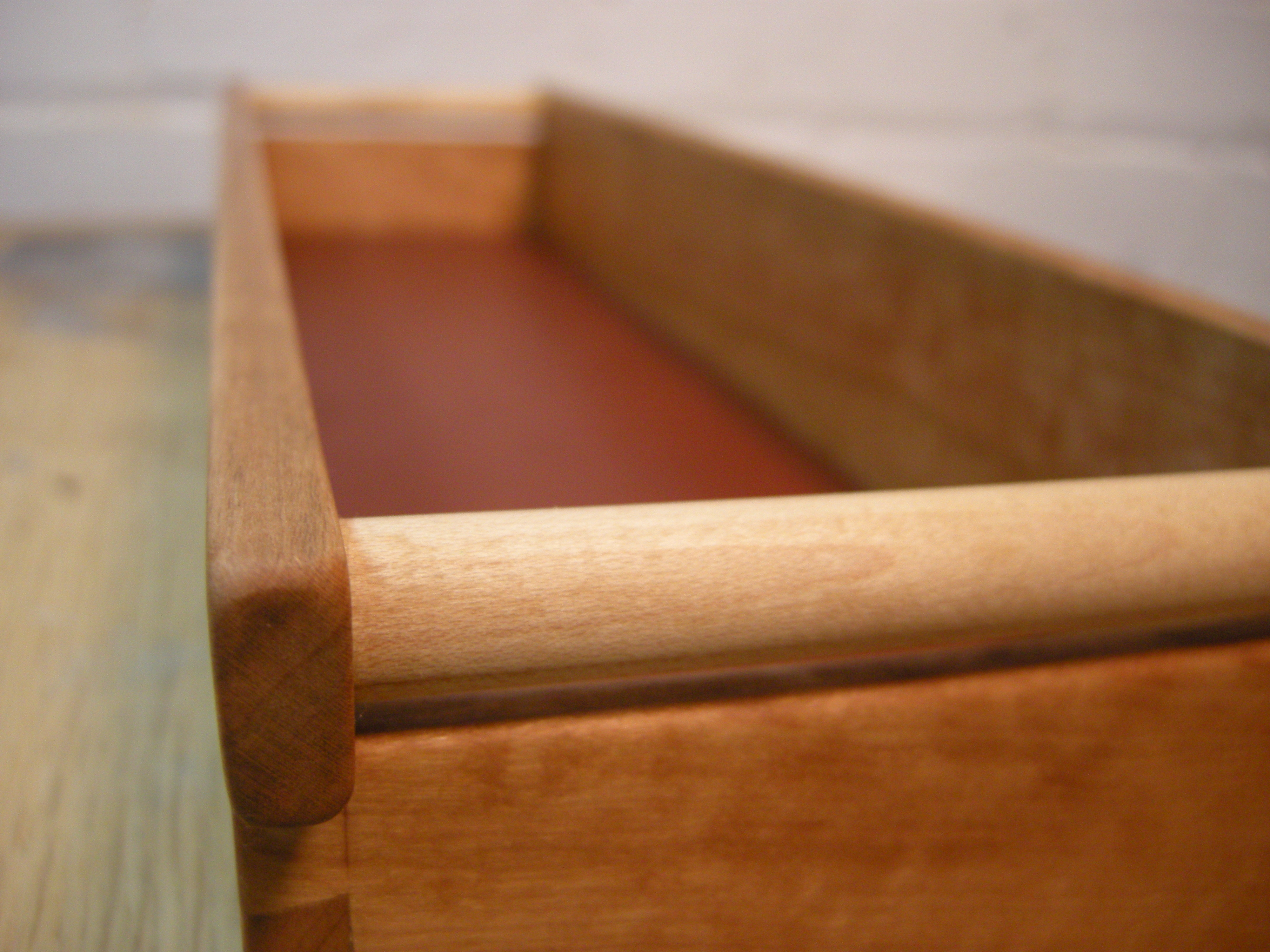 Cherry till with leather lined bottom and maple dowels.
