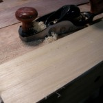 A block plane fitted with knob and tote and a toothed blade makes a great toothing plane.
