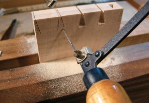 Fret-sawing the waste in both drawer sides saves time.
