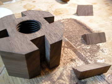 Trace the pattern on the hub stock and at the bench hook, saw away the corners of the hubs to create a rough octagon.
