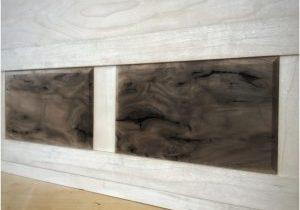 Figured walnut panels set into the maple frame.